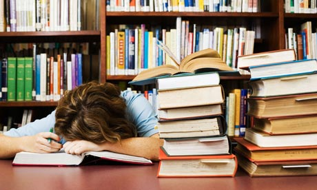 Exhausted student asleep in library